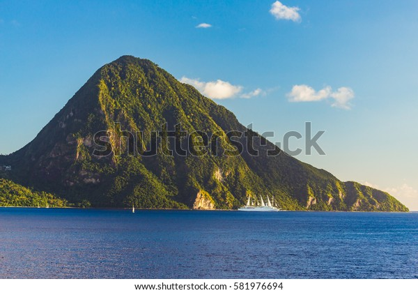 The view from the deck of a cruise ship on one of the peaks of the Pitons St. Lucia island at sunset.