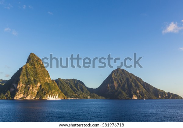 The view from the deck of a cruise ship on the two peaks of the Pitons St. Lucia island at sunset.