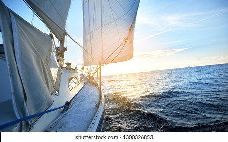 View from a deck of a tilted yacht in strong wind on evening
