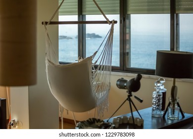 View of decorated living room, facing the sea...