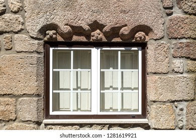 View of a decorative architave or epistyle on top of a window on an old building in Celorico da Beira, Beira Alta, Portugal