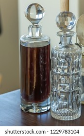 View of decorative glass bottles with liquor, indoors...