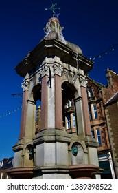 A view of a decorative ornamental fountain in Crieff, Perthshire