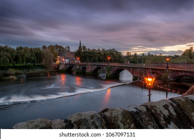 View of Dee river and the Old Dee Bridge in Chester, Cheshire, at sunset, taken from the Chester City Walls