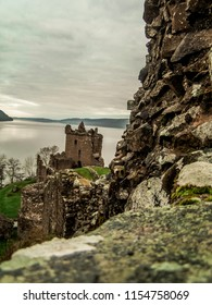 View from the defensive walls at Loch Ness Castle (Urquhart Castle). In the background you cab see Loch Ness lake.