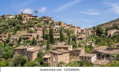 The view of Deia mountain town located in Serra de Tramuntana mountains captured during the GR221 trek. Mallorca, Spain.