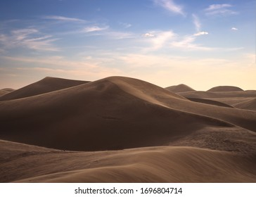 A  view of desert dunes at sunset