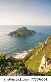 View of Deva island in a sunny day, in the coast of Bayas, Asturias, on Spain. It is the biggest island in all asturian coast.