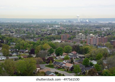 view from the Devils Punch bowl lookout point towards the  Stoney Creek community and Hamilton in the far background,  Ontario Canada