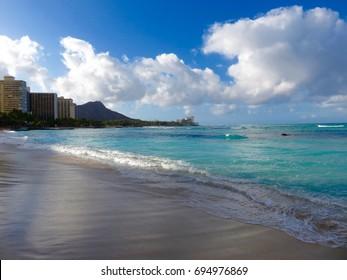 View of Diamond Head Crater - Morning Light on the Turquoise Sea at Waikiki Beach, Honolulu ,Hawaii