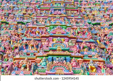 View of different god and goddess sculptures on tower at sarangapani temple, Kumbakonam, Tamilnadu, India seen with beautiful color on temple tower providing very attractive outlook