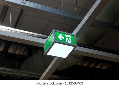 View of a directional signage for fire escape inside a building
