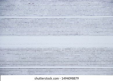 View directly overhead of pattern on metal bleachers in stadium of local high school for baseball, football or soccer sports game