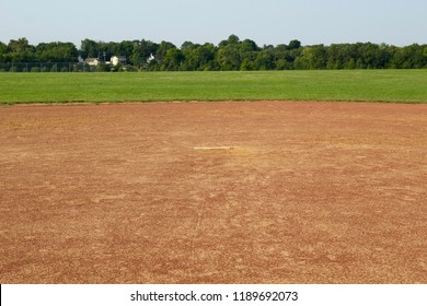 A view of the dirt infield of the baseball field from ground level.