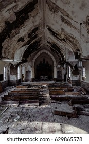 A view of discarded wood pews in an abandoned Catholic church in McKeesport, Pennsylvania.