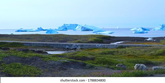 View of the Disko Island on icebergs floating in Disko Bay, Greenland
