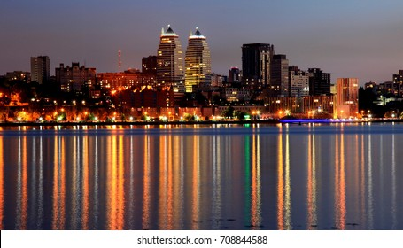 View of the  Dnepr city at night,  lights reflected on the river Dnieper, Ukraine, (Dnipro, Dnipropetrovsk, Dnepropetrovsk)