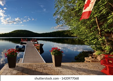 View of the dock and the lake at a cottage  on 3 Mile Lake in Ontario Canada