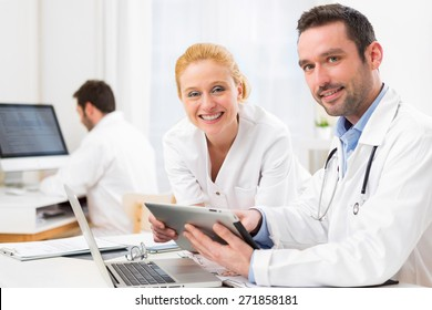 View of a Doctor and an assistant working together at the hospital