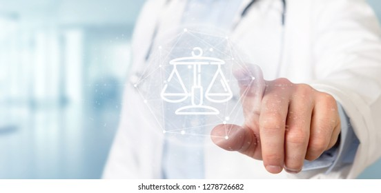View of Doctor holding Cloud of justice and law icon bubble with data 3d rendering