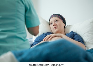 View of doctor and patient with cancer