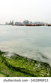 View of Doha skyline  across the sea shore