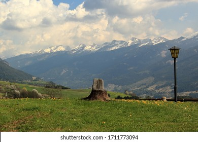 View of the Dolomites in the Val di Fiemme near Cavalese, Italy, with white clouds