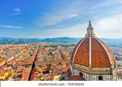 View of the dome of Florence Cathedral and the Florence city in the background on a sunny day.