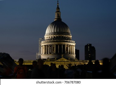 View of the dome of St Paul's Cathedral, London, designed by Sir Christopher Wren. Dome is illuminated at night. Photo taken from The Millennium Bridge, August 2017
