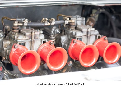 View of a double carburetor at an old classic car at the meeting in Wesseling near North Rhine Westphalia 09.02.2018