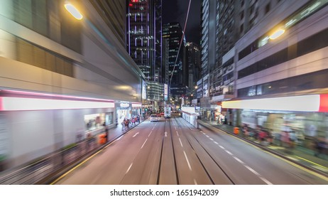View from double-decker tram on street of HK timelapse hyperlapse drivelapse. Hong Kong Tramways is a tram system in Hong Kong, being one of the earliest forms of public transport in the metropolis.