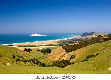 The view down to Bare Island and the coastal settlement of Waimarama in Hawke's Bay, East Coast of the North Island, New Zealand.