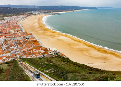 View down to the beach and coast along the town of Nazare in Central Portugal