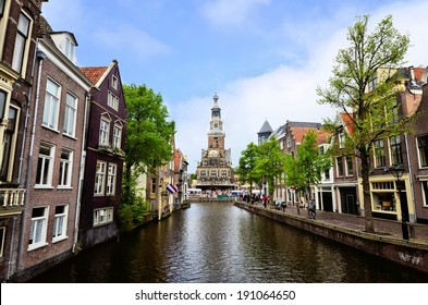 View down a canal in the Old Town of Alkmaar towards the Weigh House, Netherlands