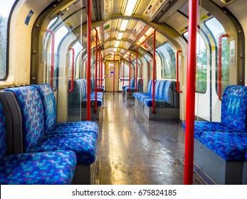 View down empty London underground train no people