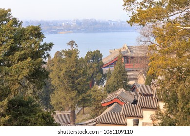 View down a hillside over historic buildings at Beihai Park, Beijing, China in March 2018.