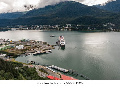 View down to the Juneau harbor from cable car with cruise ship and docks