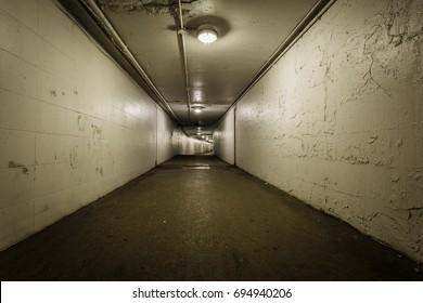 View down a long dark tunnel