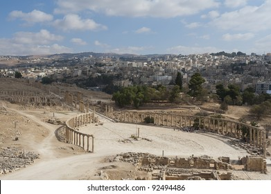 View down onto the Oval Plaza in the ancient Roman city of Jerash, Jordan. You can see the modern city of Jerash in the background.