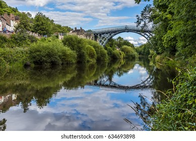 The view down the River Severn of the town of Ironbridge, Shropshire, UK and the bridge that gave it its name