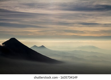 View down a valley from Acatenango volcano during sunrise