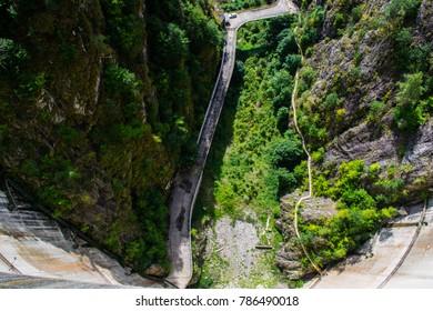 View down the wall of Vidraru hydroelectric dam in Transylvania, Romania