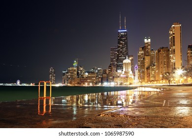 View of downtown Chicago and Lake Michigan after sunset.
