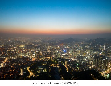 View of downtown cityscape and city slyline in Seoul, South Korea during sunset