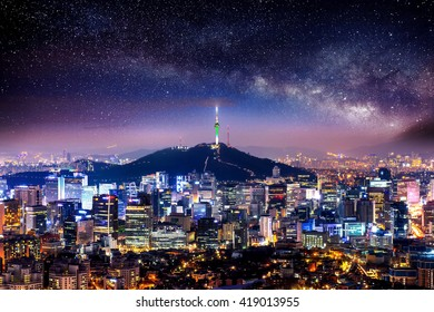 View of downtown cityscape and Seoul tower with Milky way in Seoul, South Korea.