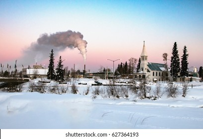 view of downtown fairbanks alaska across frozen chena river on clear winter morning