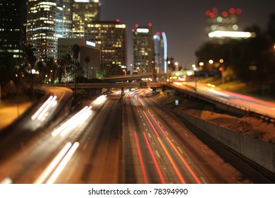 view of downtown los angeles and freeways at night with a tilt shift lens