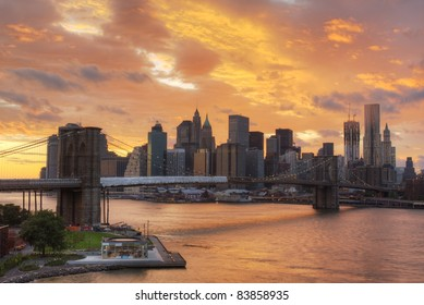 View of Downtown New York City with dramatic clouds.