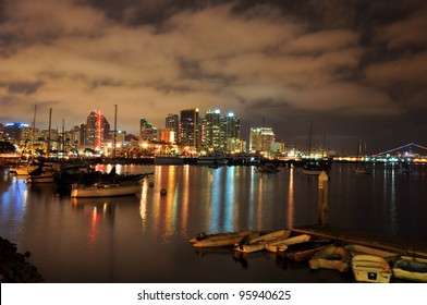 View of the downtown San Diego skyline and harbor at night in Southern California.