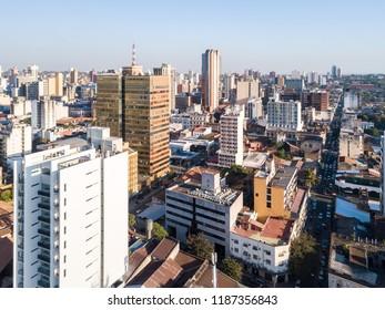 View of downtown skyscrapers of Latin American capital of Asuncion city, Paraguay. Avenida Montevideo. Birds eye aerial drone photo. Ciudad de Asunción Paraguay. South America.